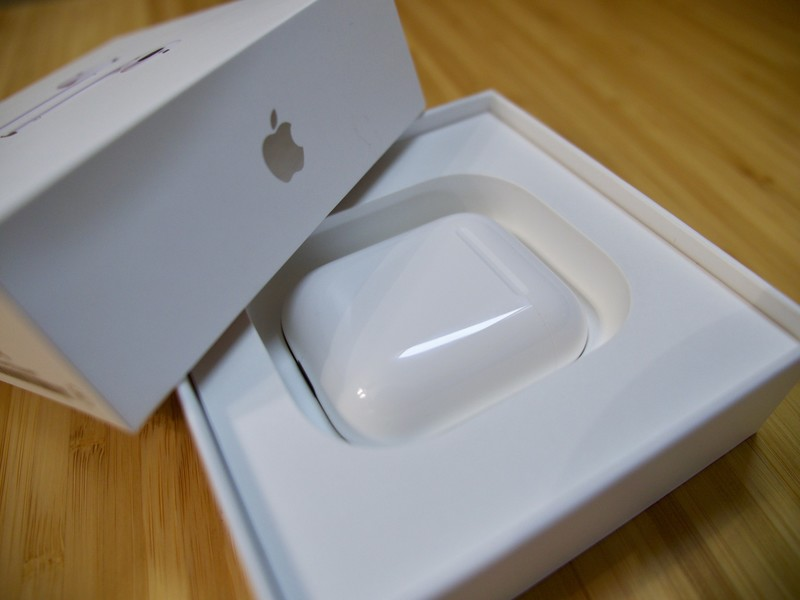 The AirPods case rests in its box.