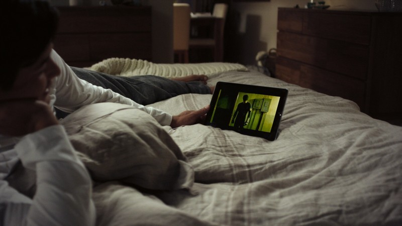 Person watching Netflix in bed