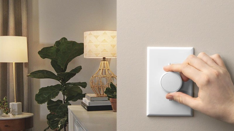 Lutron Aurora being activated by hand in a room setting