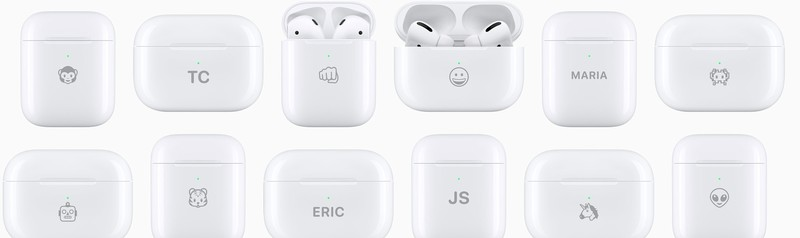 AirPods charging cases with various emoji engraved