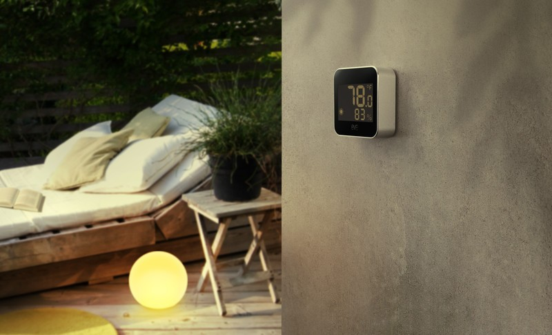Eve Weather mounted on a wall in an outdoor setting