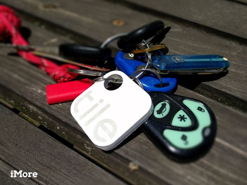 A keychain with a Tile bluetooth tracker