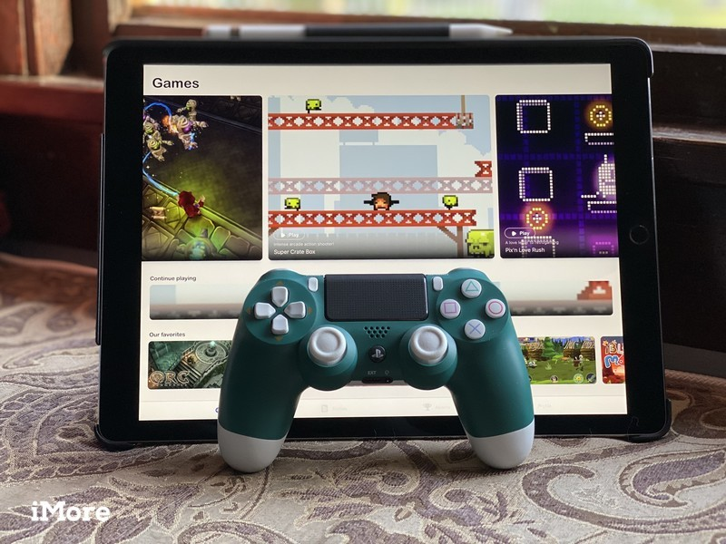 iPad Pro with GameClub and a green DualShock 4 controller