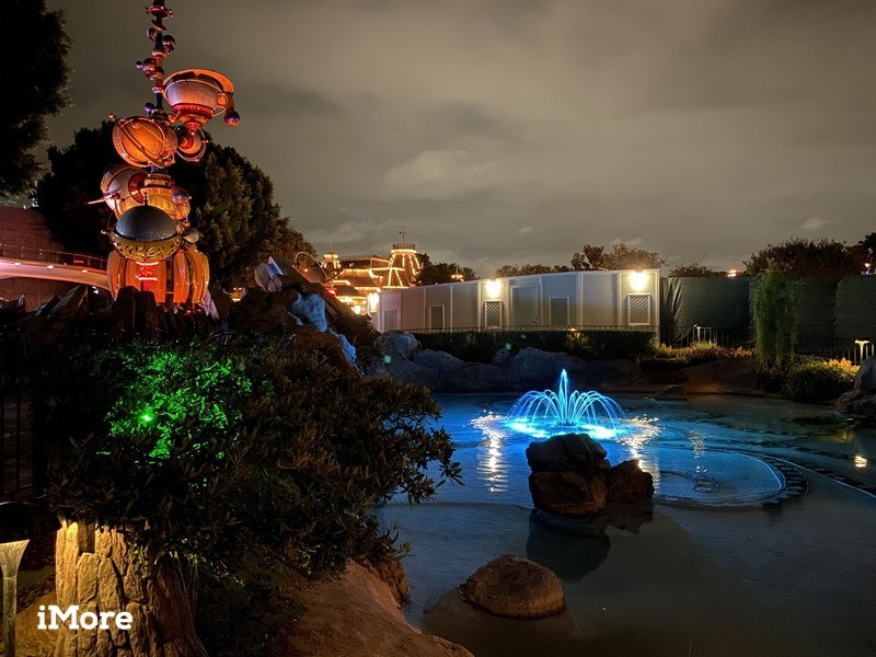 Pixie's Hollow fountain in front of Tomorrowland in Night mode