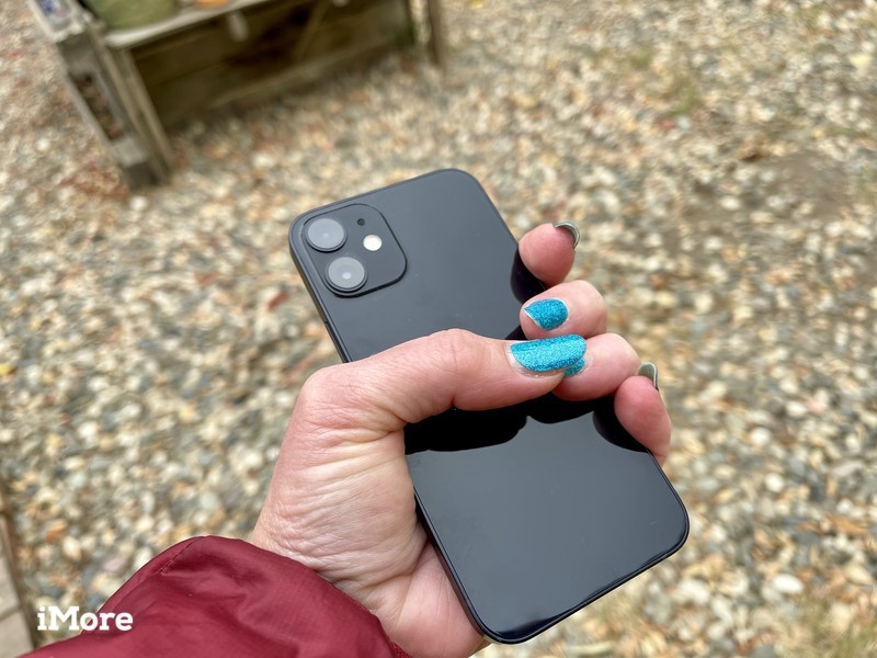iPhone 12 mini gripped by one hand