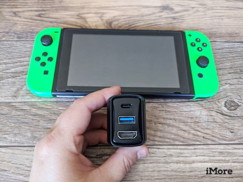 Genki Covert Dock In Hand Next To Switch