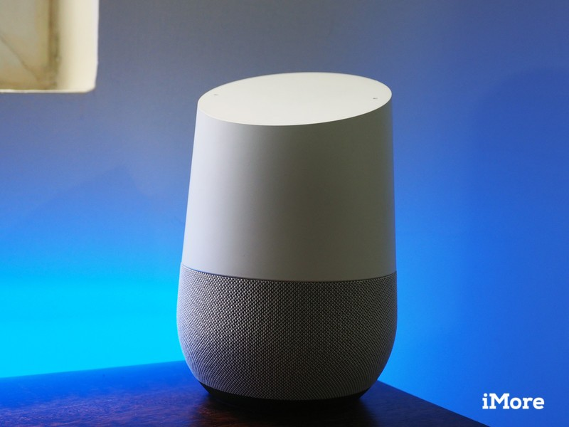 Google Home with blue lighting behind it