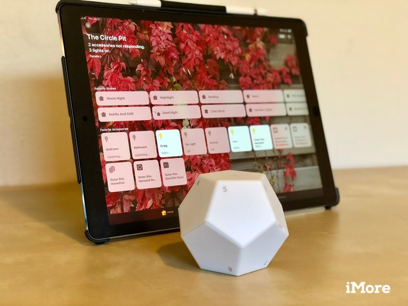 Nanoleaf Remote on a flat surface in front of an iPad