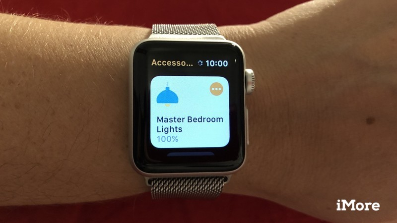 Home app displayed on an Apple Watch that is worn on a wrist