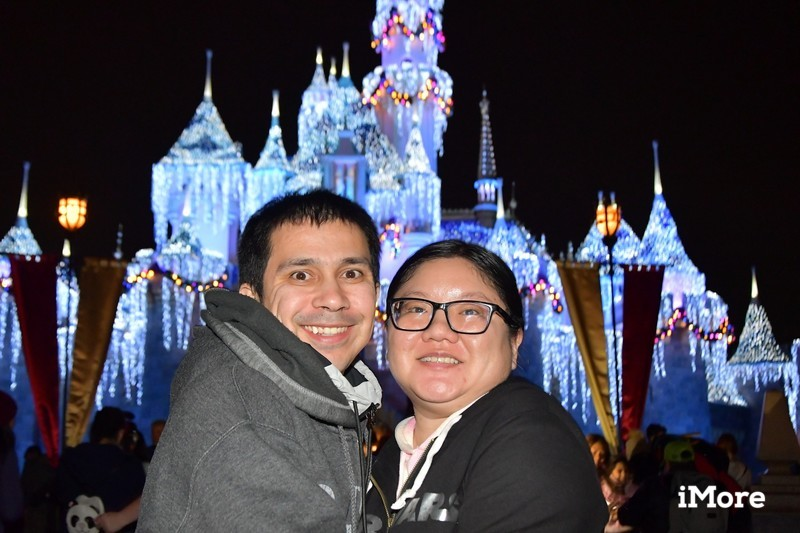 Christine and Robert in front of holiday Sleeping Beauty's Castle at Disneyland