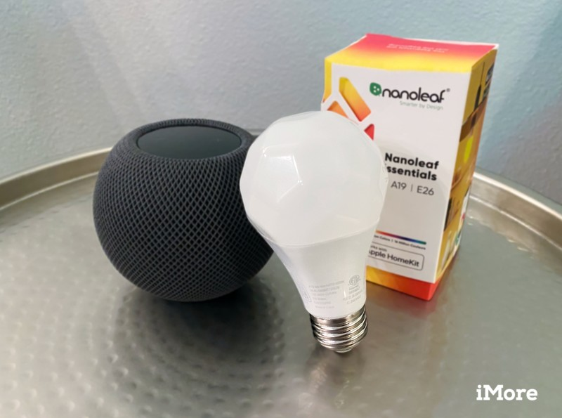 Nanoleaf Essentials A19 Light Bulb and Packaging next to a HomePod mini