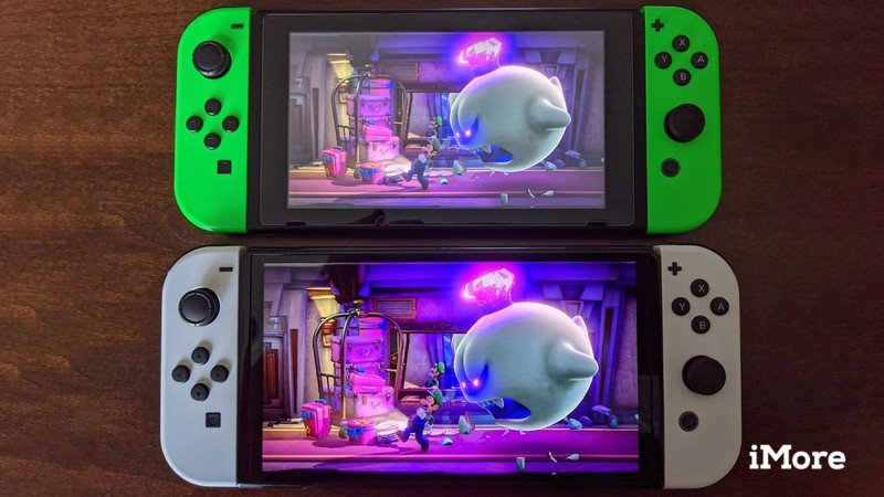Nintendo Switch Oled Model Next To Switch V2 Luigis Mansion 3 With King Boo