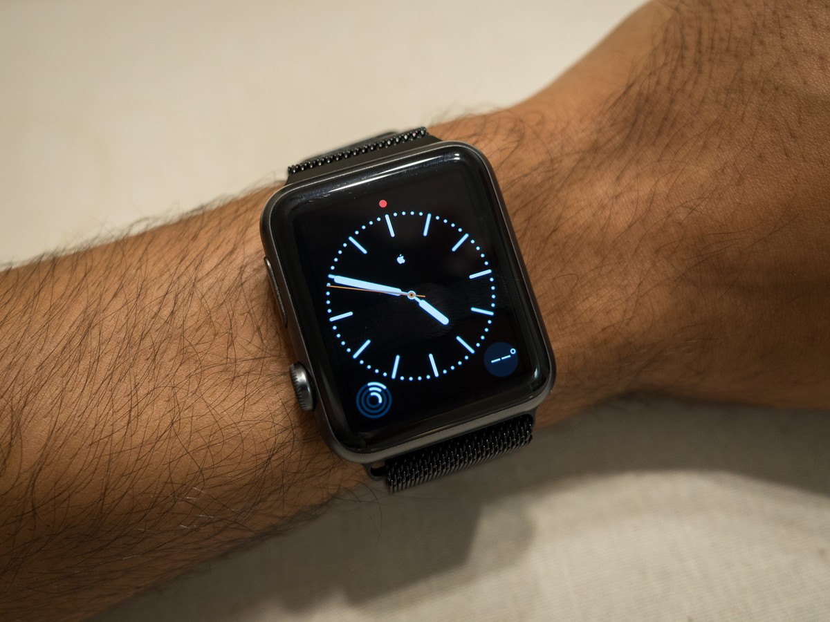 A Space Gray Apple Watch Sport with a black Milanese Band.