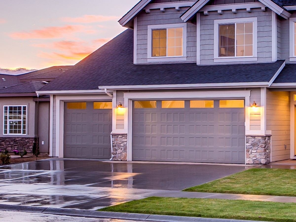 A garage door is shown at the front of a home