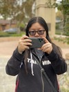 Christine takes a photo with the Smart Battery Case camera button