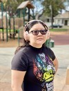 Christine wears her Rose Gold Bose QuietComfort 35 II headphones