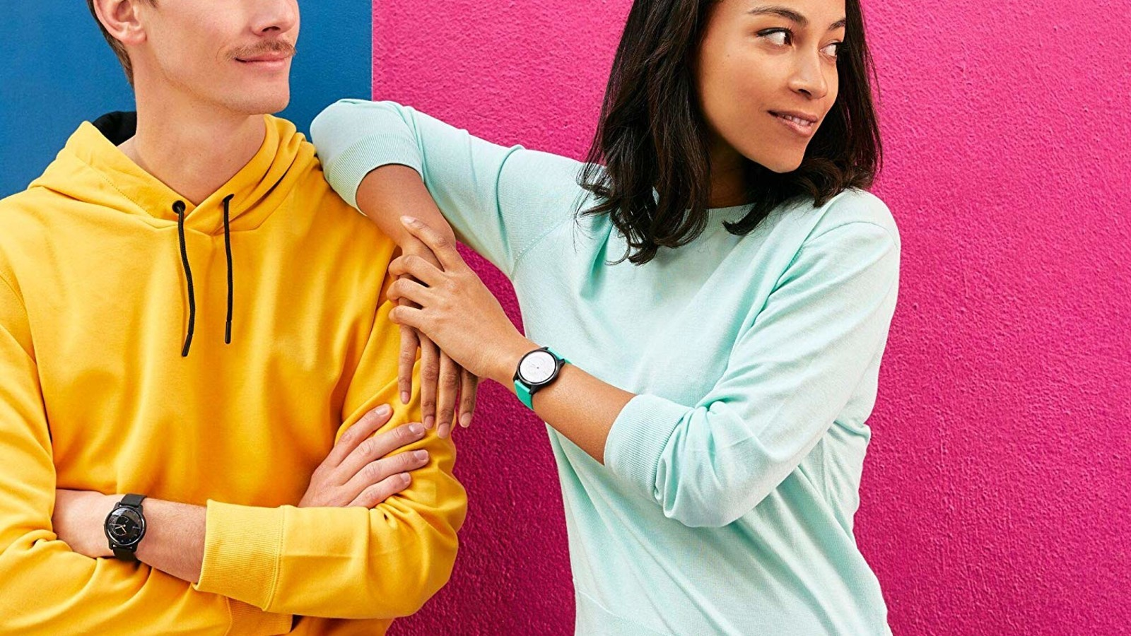 man and woman wearing Withings Move different colors