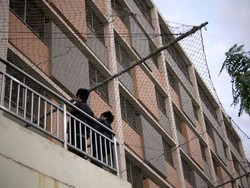 Foxconn buildings covered in suicide nets, though most workers are just sleepy and bored