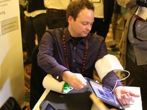 Withings demonstrates iPhone interface for scale, blood pressure readings, baby monitor - TiPb at CES 2011