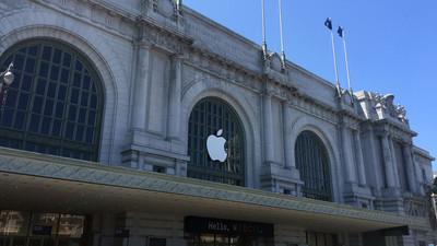 Bill Graham Civic Auditorium is shown with an Apple logo prominently displayed in the window.