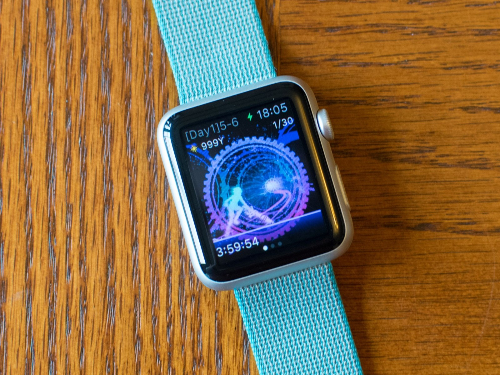 An Apple Watch is shown with the Cosmos rings wallpaper.