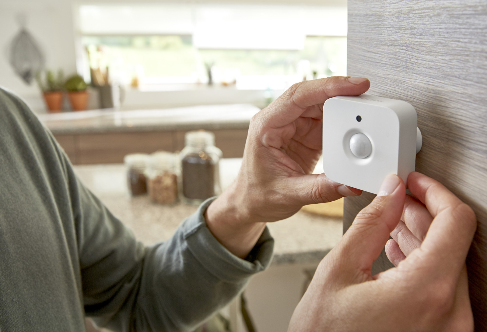 Philips Hue Motion Sensor installed at an angle.