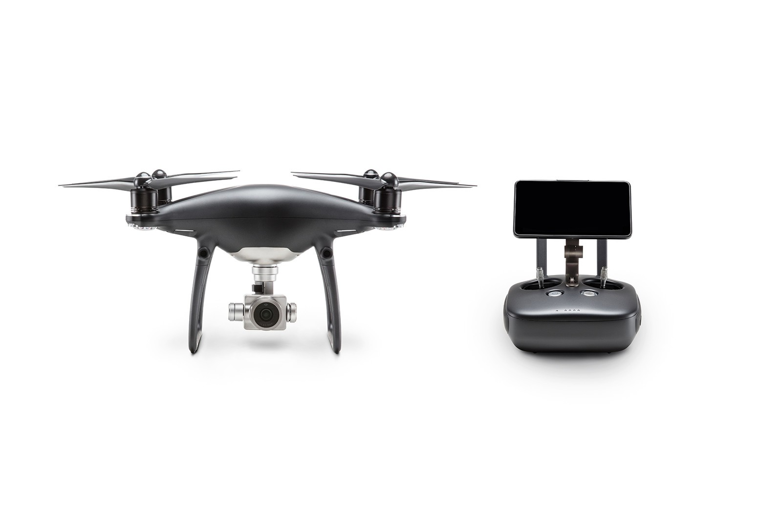 The matte-gray Phantom 4 Pro Obsidian drone and its matching controller sitting stationary against a white background