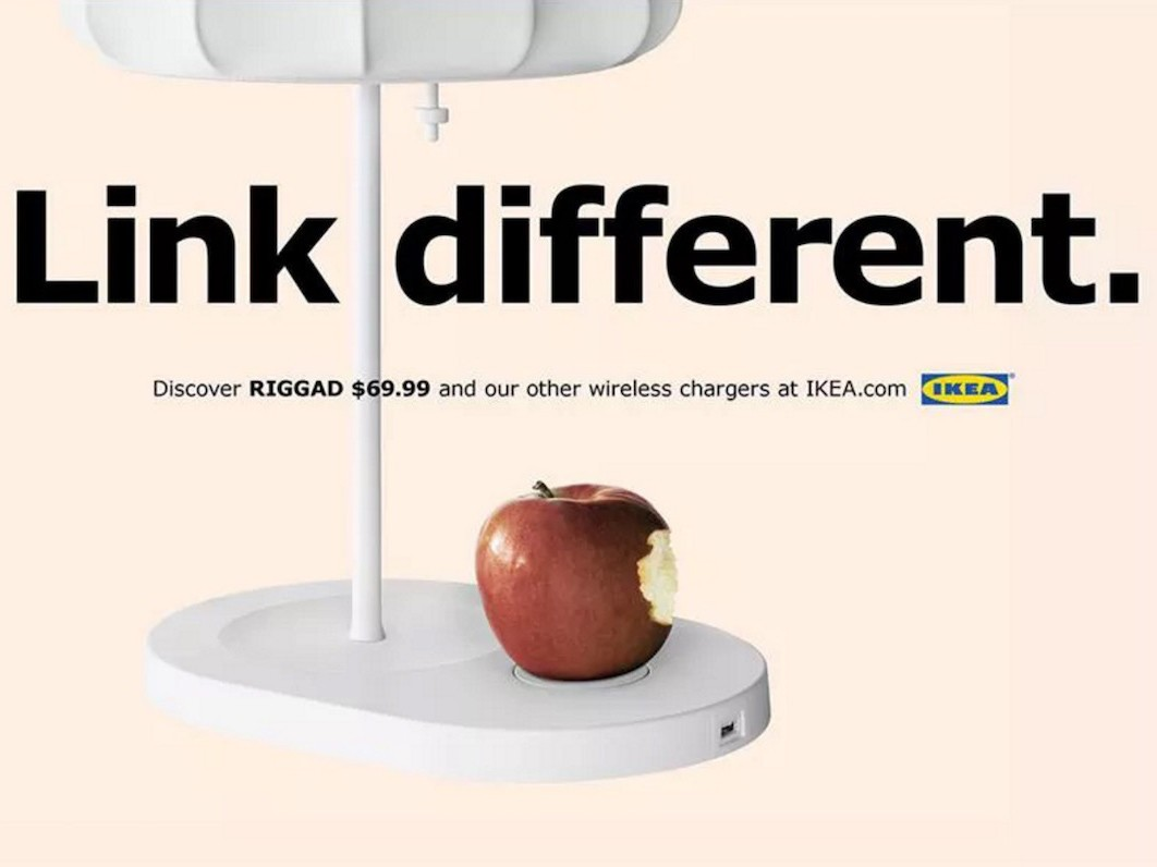 an IKEA ad showing a Qi wireless charging lamp with text that reads 'This charges everything.'