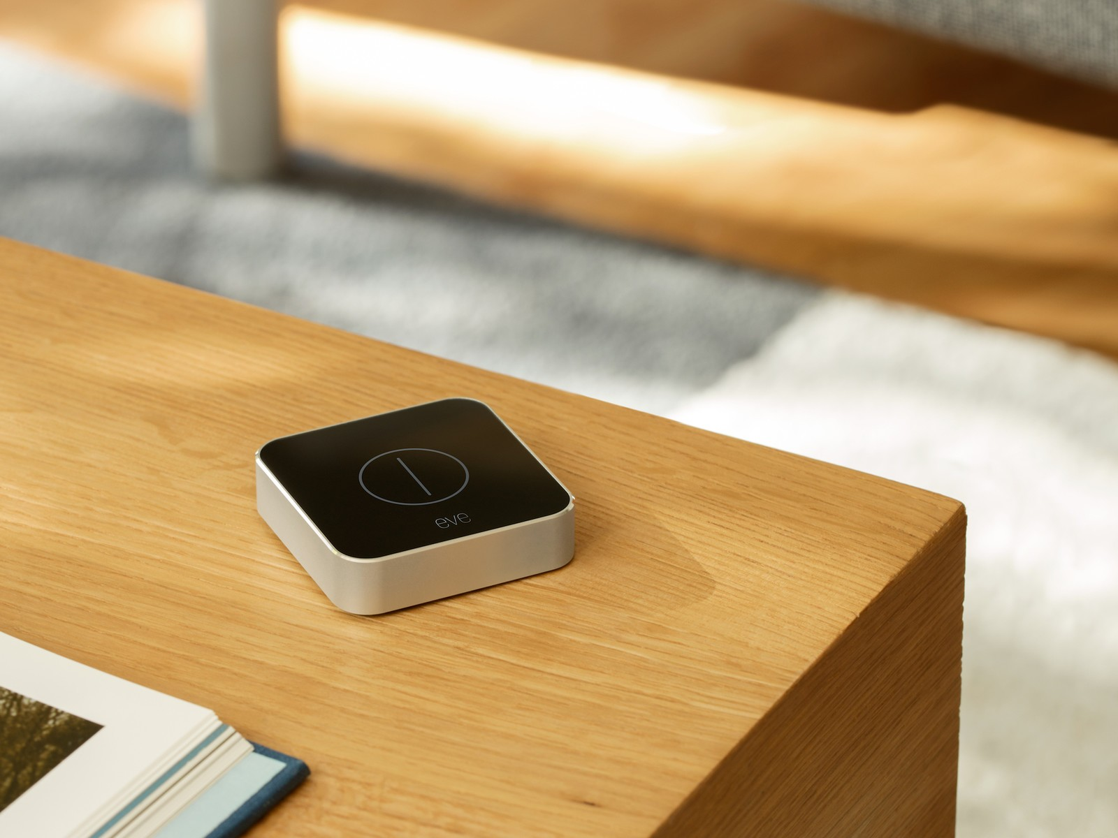 The square Eve Button resting atop a white shelf