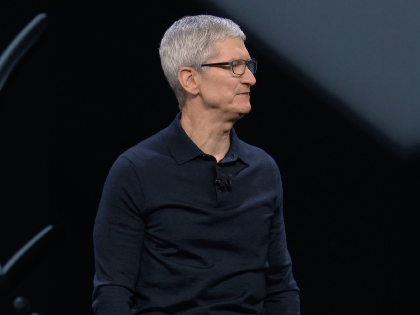 Tim Cook looks across the stage at Apple's WWDC event in 2018