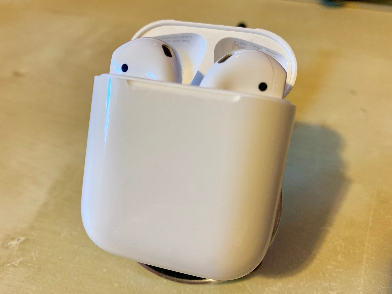 AirPods in their case
