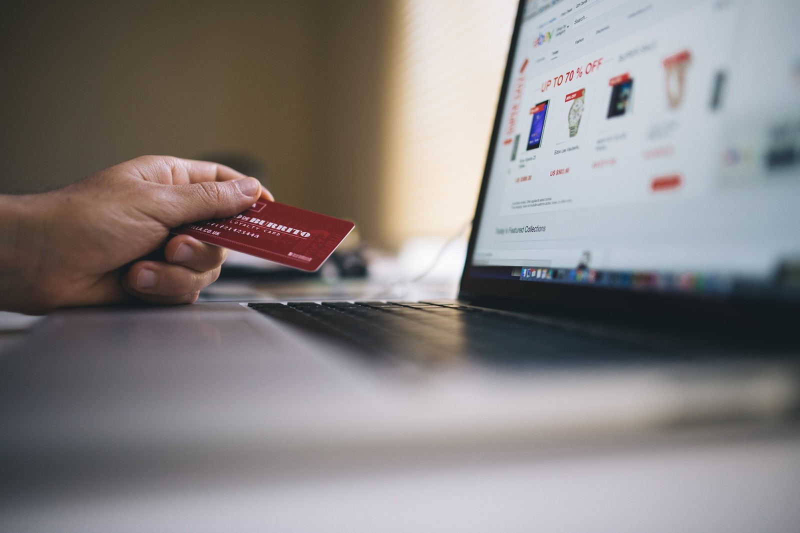 Person shopping online with a credit card