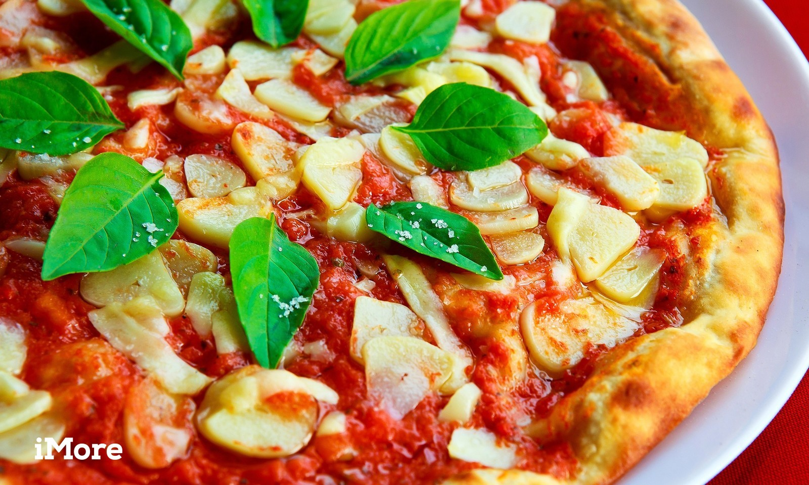 A pizza sits on a plate.